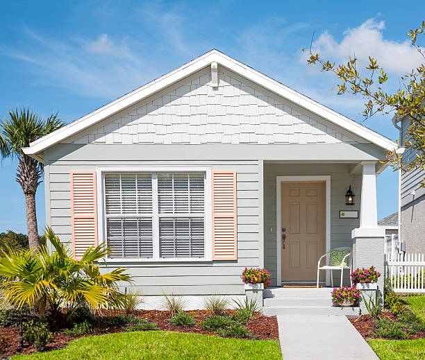small cottage - bungalow stock photos and pictures