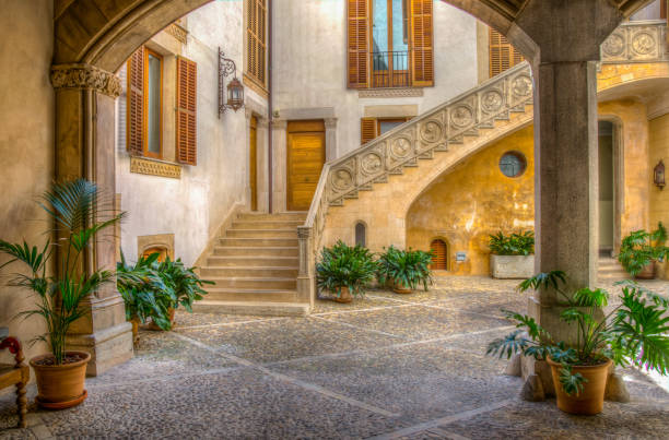 A small courtyard in Palma de Mallorca, Spain A small courtyard in Palma de Mallorca, Spain courtyard stock pictures, royalty-free photos & images
