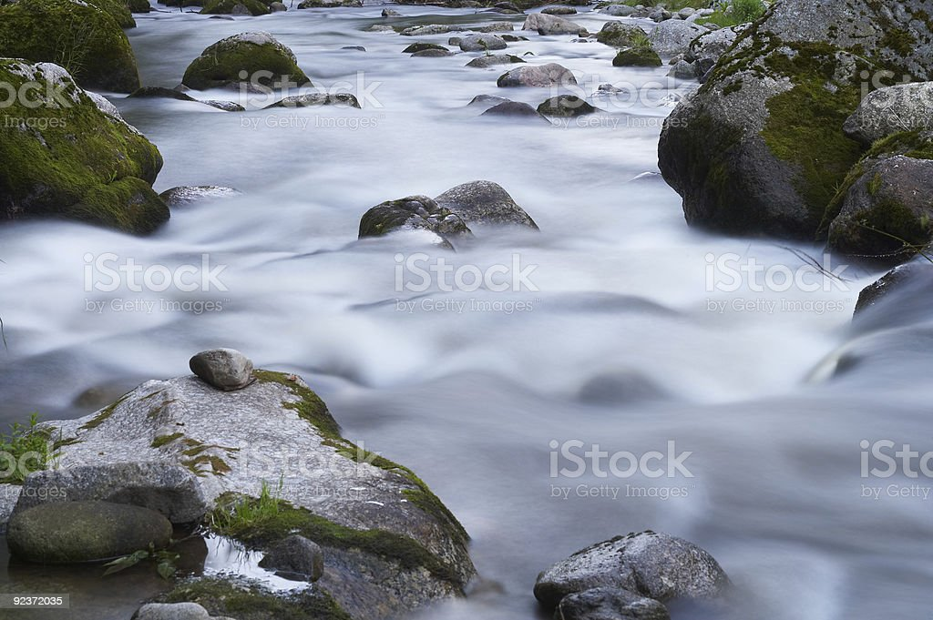 small creek with a lot of stones and rocks royalty-free stock photo