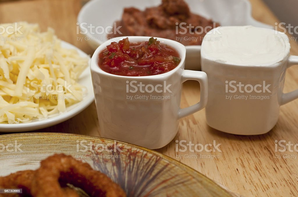 Small cup filled with salsa royalty-free stock photo