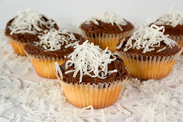 Small Cupcakes with Coconut and Chocolate Icing stock photo