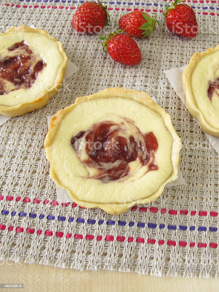Small curd cheese cakes with strawberry jam stock photo