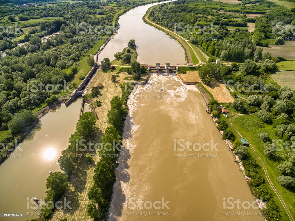 Small dam regulating the flow on channel stock photo