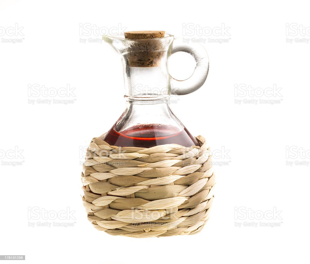 Small decanter with red wine vinegar isolated on the white royalty-free stock photo