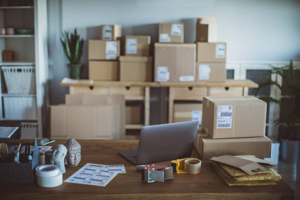 Small delivery business Small business online shop workplace. Card boxes for packing and delivering, and other stuff needed for delivery business sell online stock pictures, royalty-free photos & images