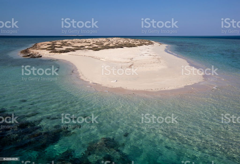 Small desert island in the sea stock photo