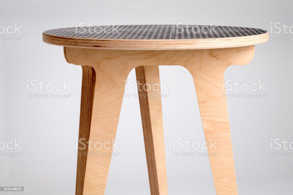 Small Designer Wooden Round Table with Black Vinyl Covered Top stock photo