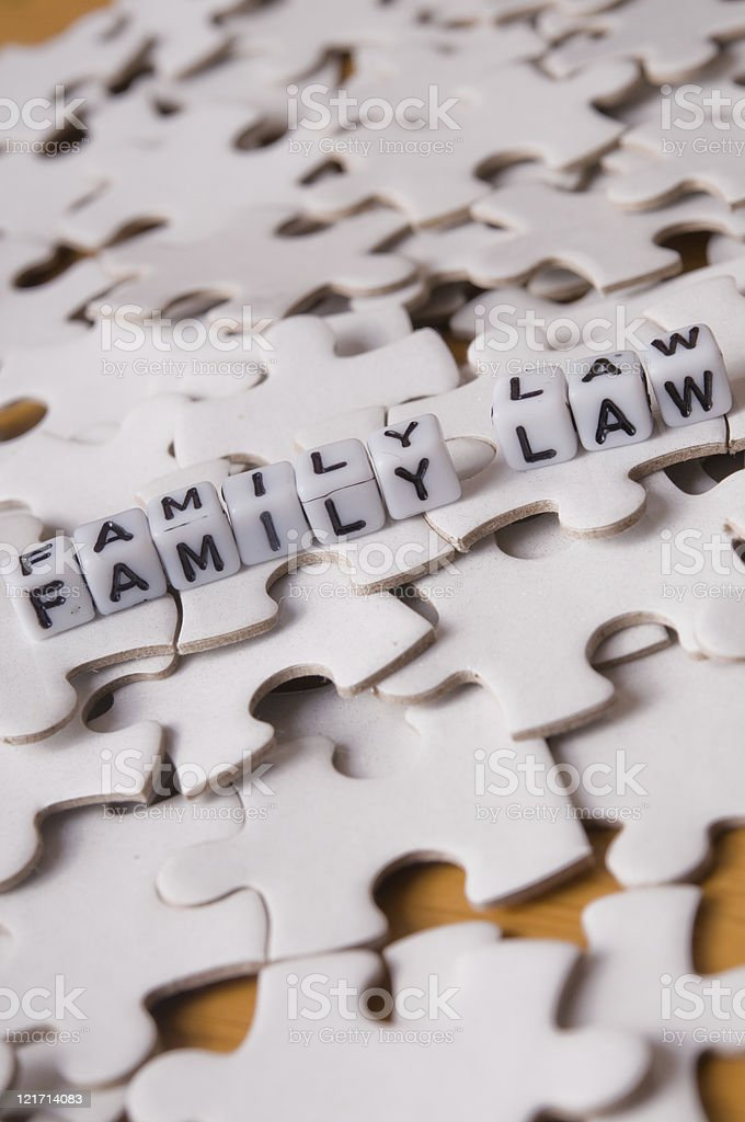 Small dices each with one letter that reads Family Law royalty-free stock photo