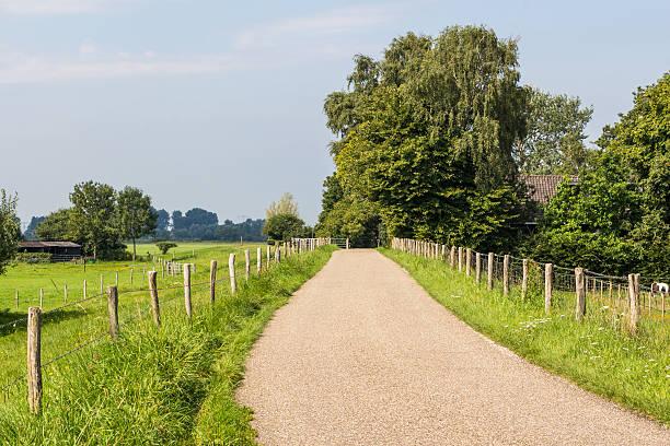 Small dike road along the Vecht  in Overijssel Holland foto
