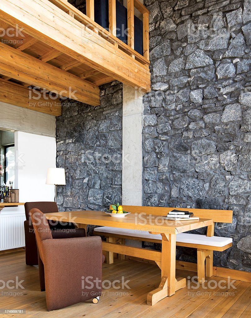 A small dining room in a rustic house stock photo