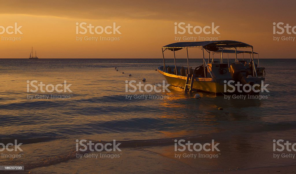 small diving boat at sunset royalty-free stock photo