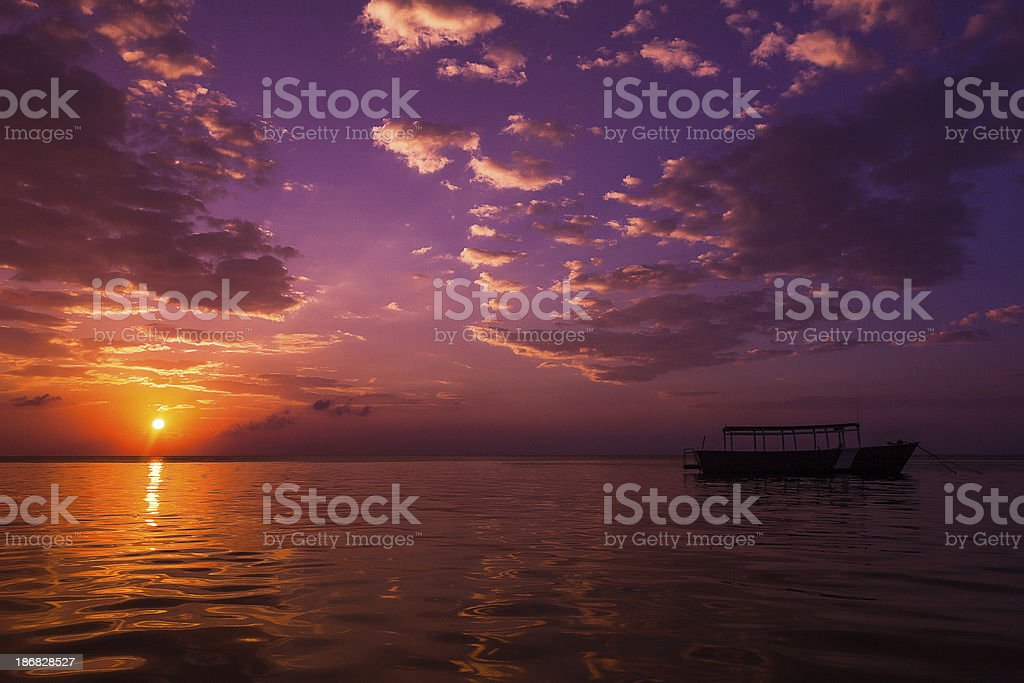 small diving boat at sunset stock photo