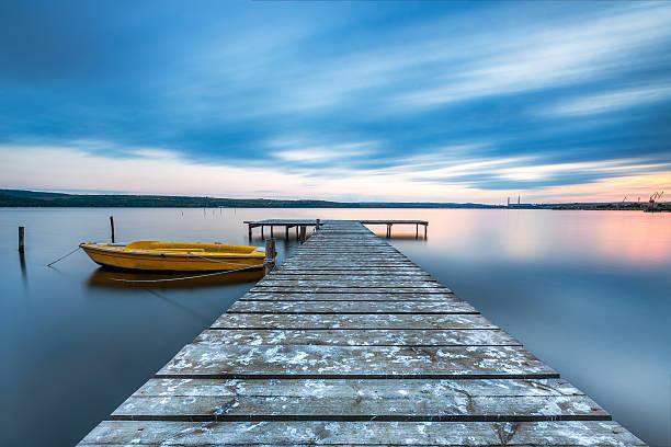 small dock and boat at the lake - flod vatten brygga bildbanksfoton och bilder