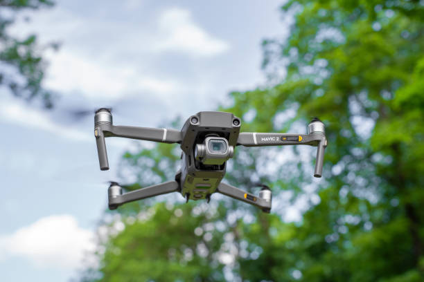 Small drone hovering in air Saku/ Estonia- June 20 2020: DJI Mavic 2 Pro hovering in the air. Cloudy sky at background drone point of view stock pictures, royalty-free photos & images
