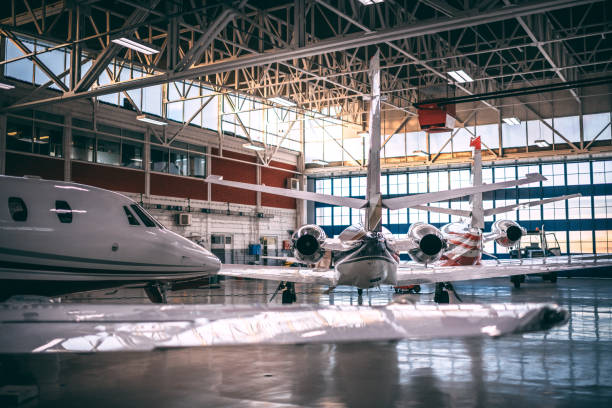 Small dual-motor airplanes stored in an aircraft hangar stock photo