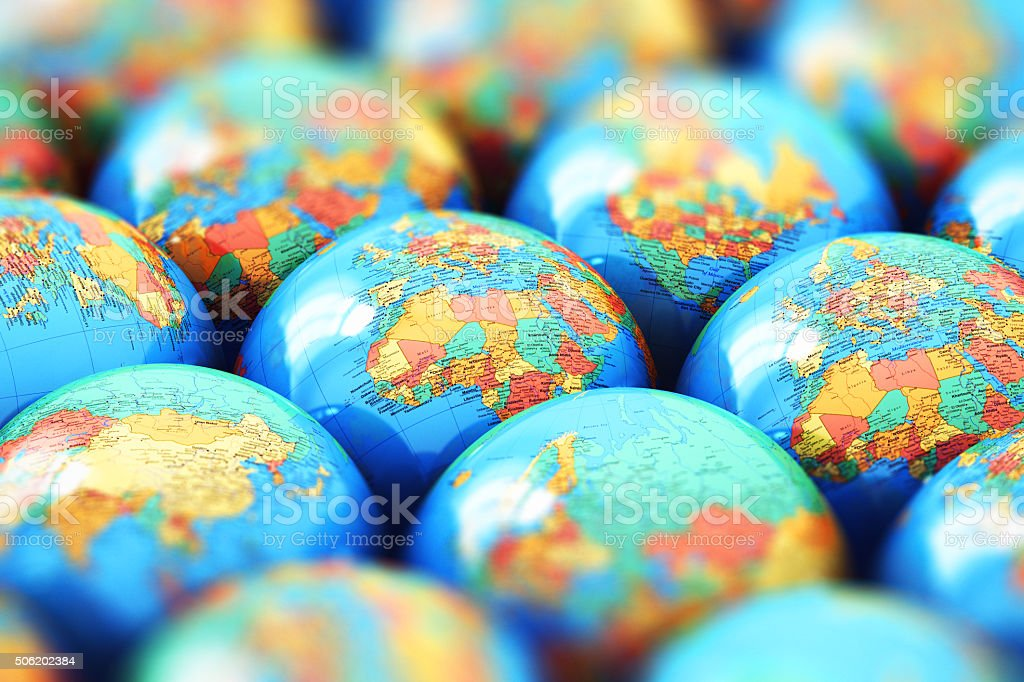Small Earth globes with world maps stock photo