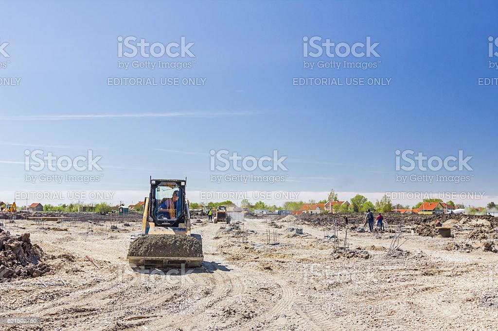 Small earth moving machine. stock photo