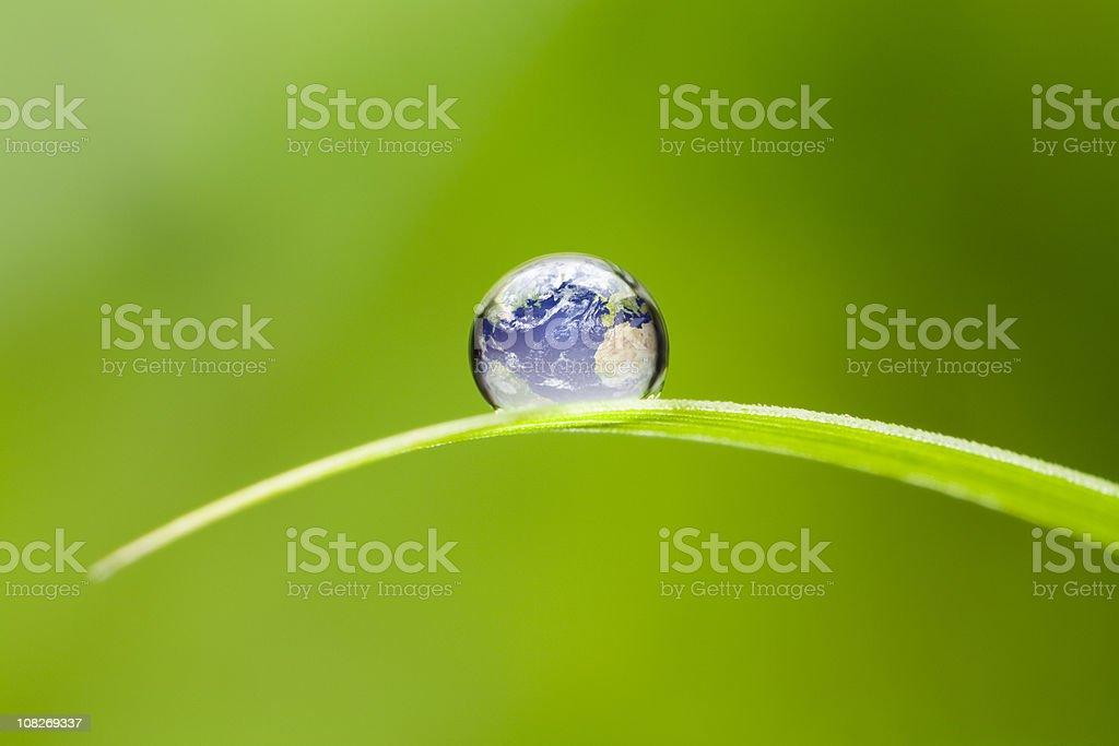 Small Earth. Nature Water Environment Green Drop Globe World royalty-free stock photo