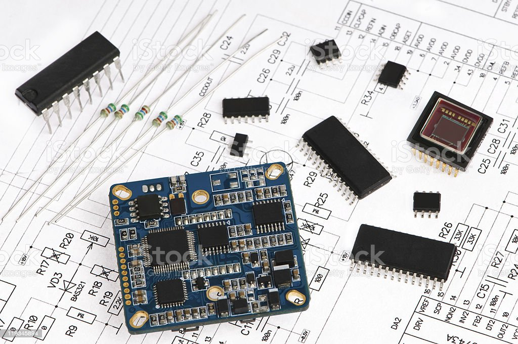 Small electronic components on circuit diagram royalty-free stock photo