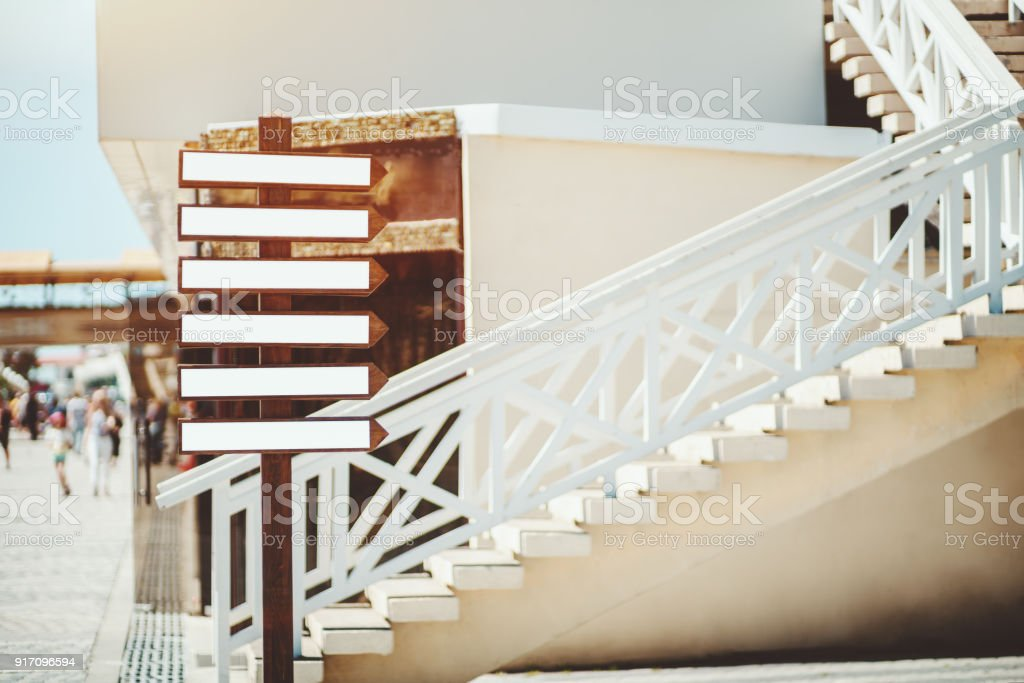 Small empty banners with shape of arrows on street pillar stock photo