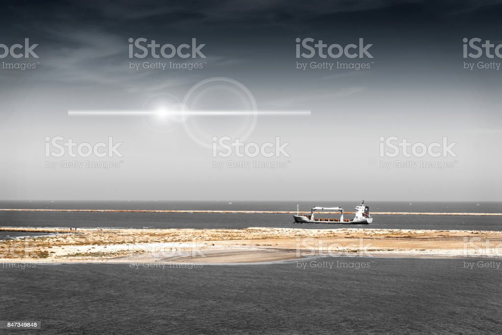 Small, empty container ship in the Mediterranean at Port Said before entering the Suez Canal stock photo