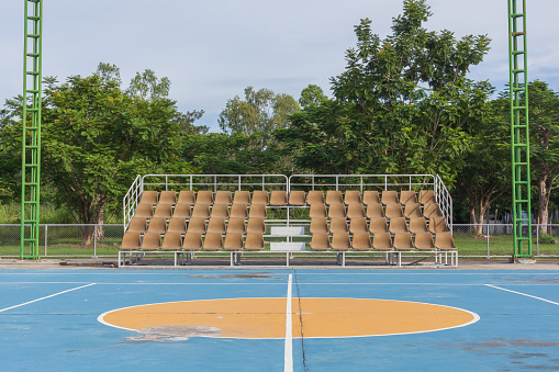 171581046 istock photo Small empty old brown grandstand with seating 491876056