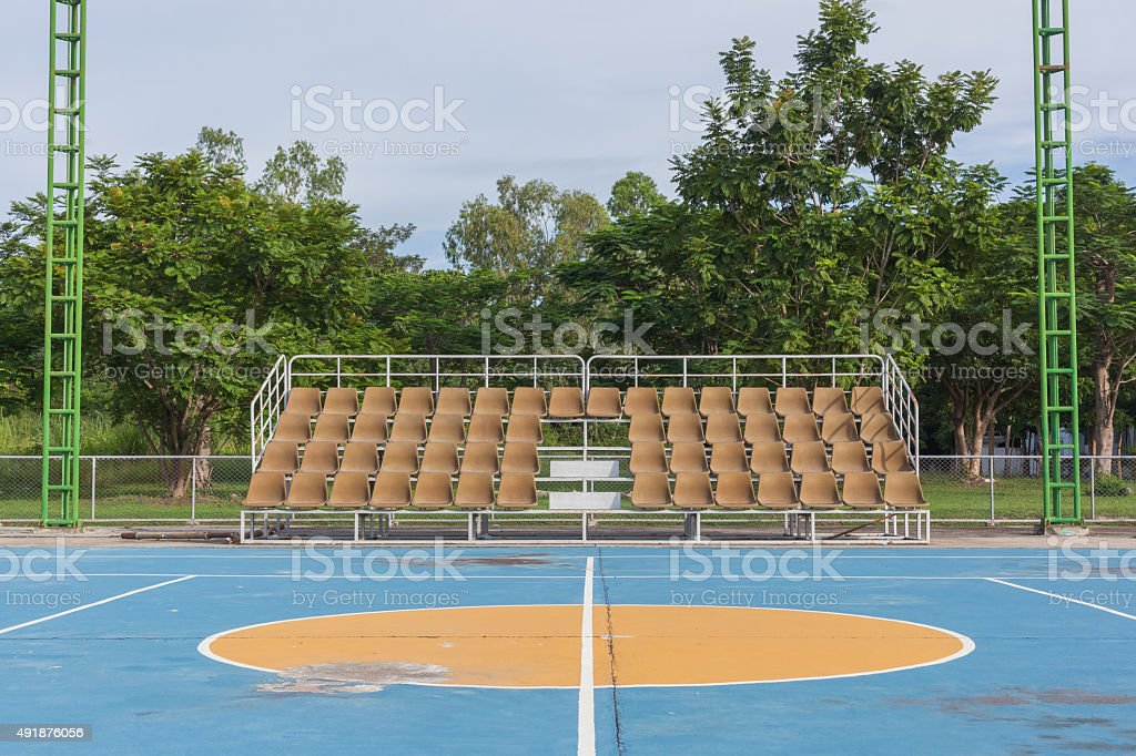 Small empty old brown grandstand with seating stock photo