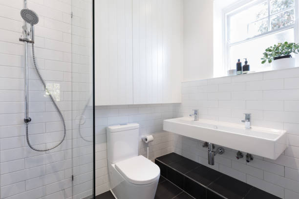 Small ensuite bathroom with tiling laid in a brick pattern stock photo