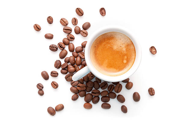 Small espresso cup with coffee beans isolated on white backgroun stock photo