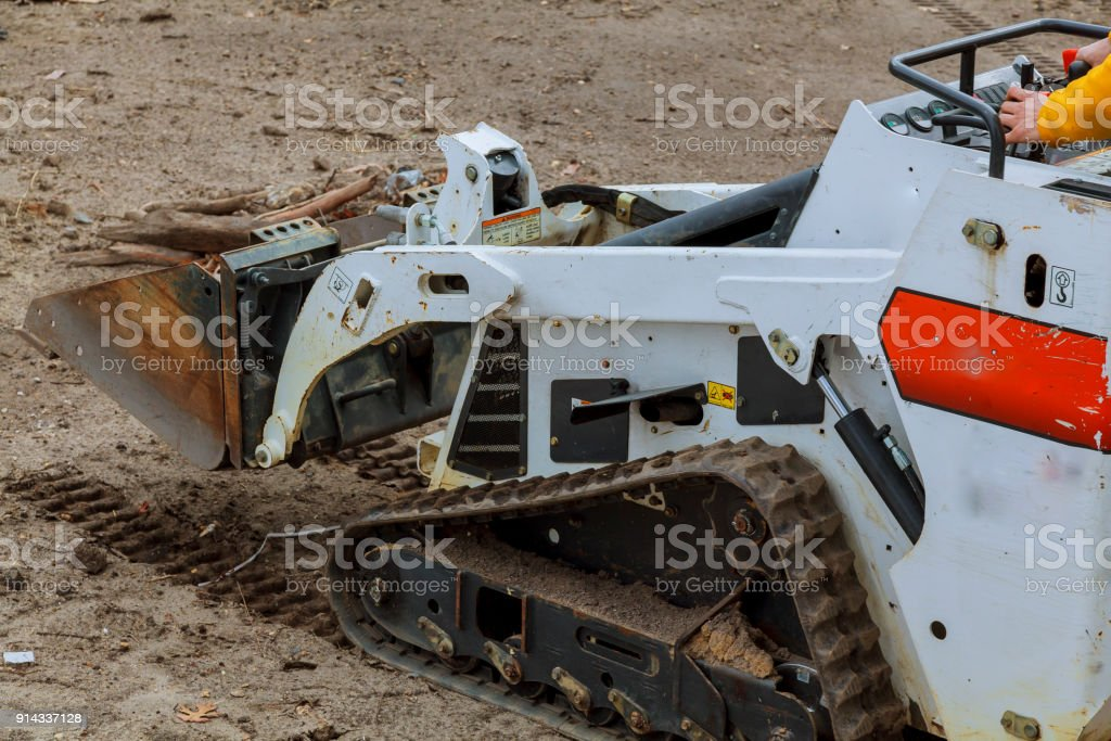 small excavator Bobcat at construction site Skid loader on construction site stock photo