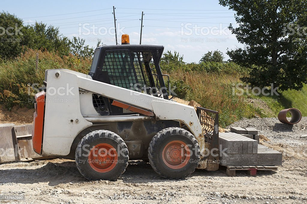 small excavator Bobcat stock photo