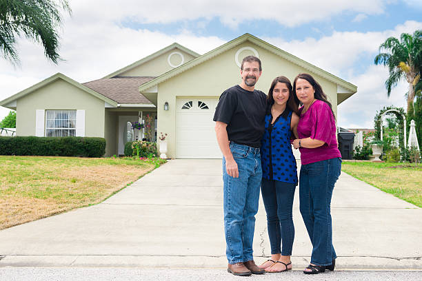 small family poses in front of new home - orlando florida photos stock photos and pictures