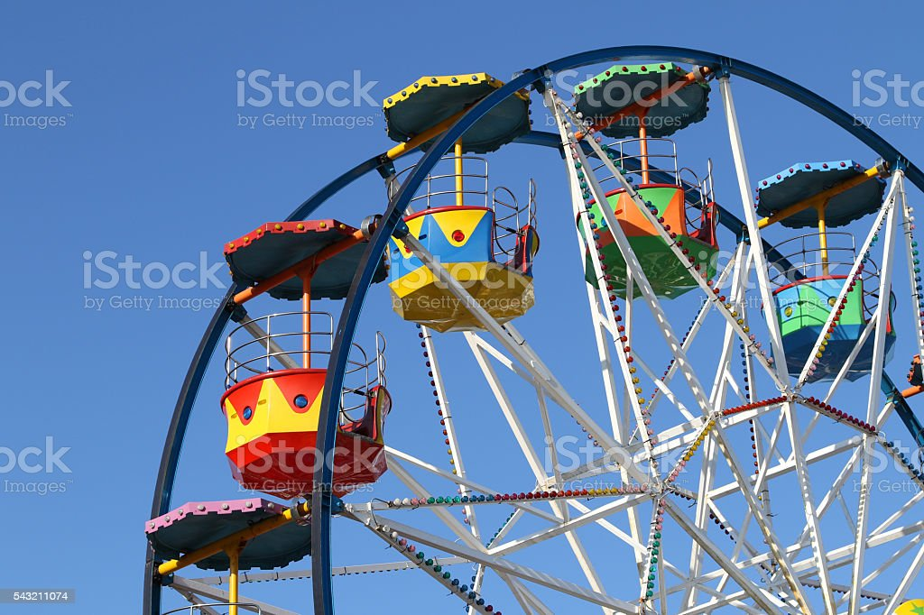 Small Ferris Wheel at a Seaside Amusement Park stock photo