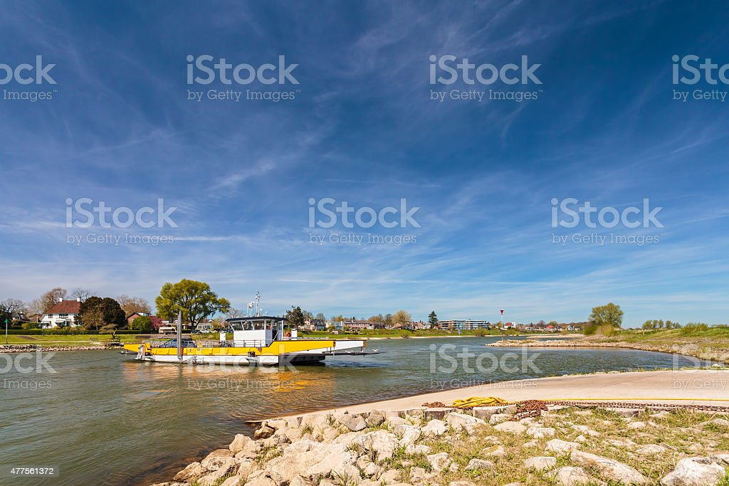 Small ferry crossing the Dutch river IJssel stock photo