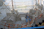 A trawler just returned to port, with small catch still hanging in the net