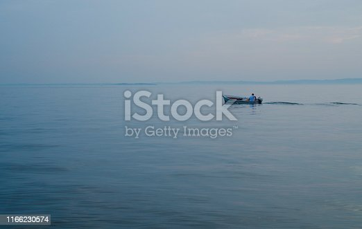 Small fisherman boat on a lake in Italy 2019