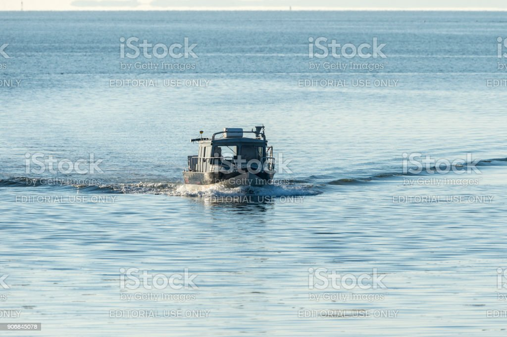 Small fishing boat approaching New Bedford stock photo