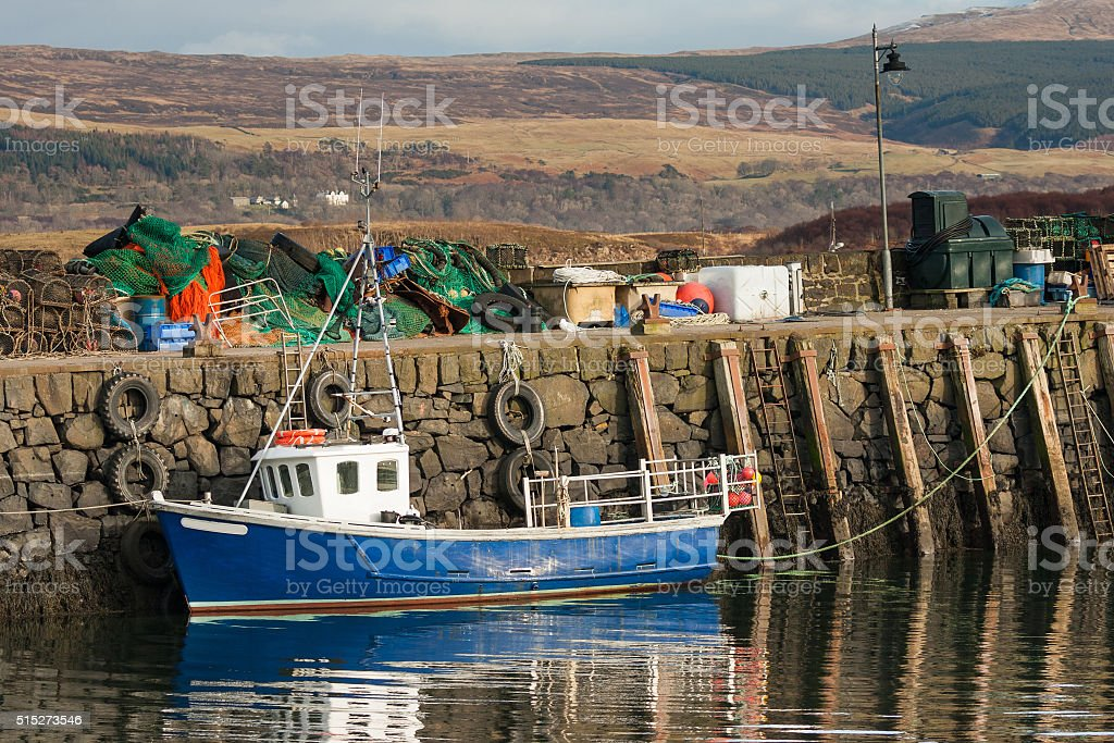 small fishing boat at tobermory harbour wall stock photo