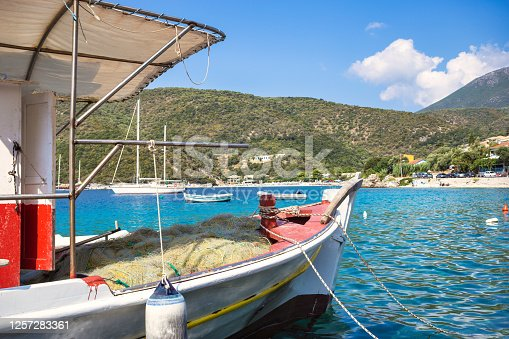 Detail of an wooden fishing boat with fishing nets in a small marina in Poros bay on Lefkada island, Greece.