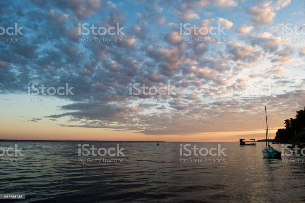 small fishing boat on beach with sunset background in the morning royalty-free stock photo