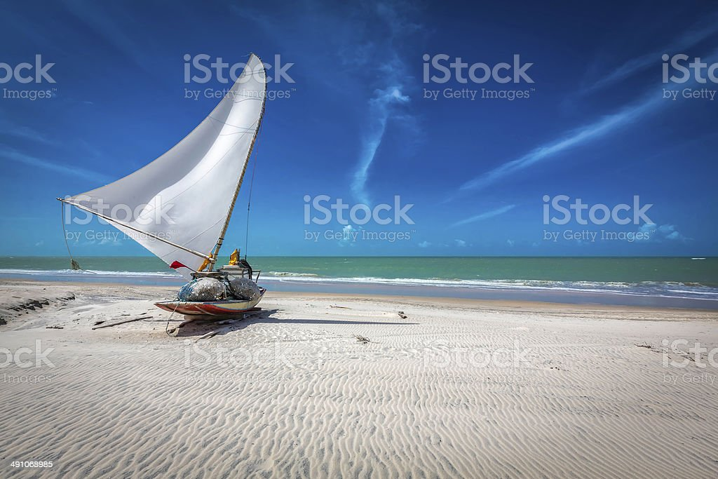 Small fishing boat on the beach of Natal, Brazil stock photo