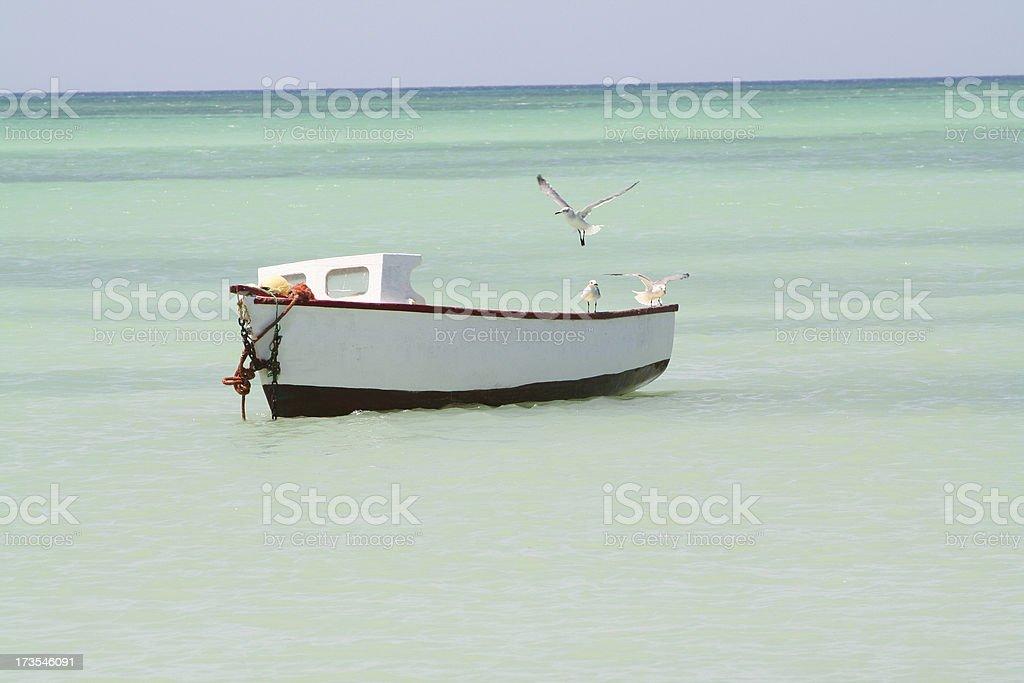 Small Fishing Boat on the Caribbean Sea in Aruba stock photo
