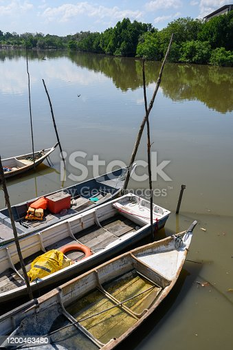 Image of Small fishing boat parking at Mangroves line the shoreline near Port Klang, Malaysia