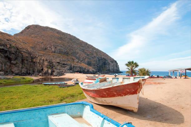 Small fishing boat / ponga at Punta Lobos beach on the coast of Baja California Mexico BCS stock photo