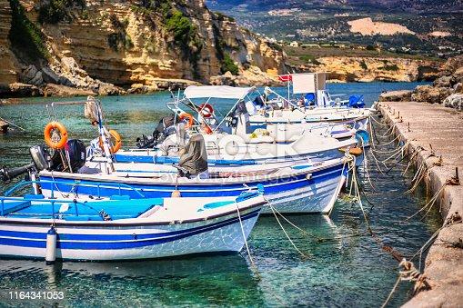 Fishing boats in the small port of Pessada village, Kefalonia island, Greece