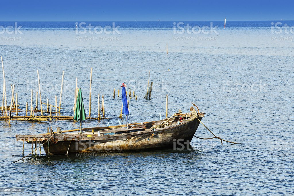 Small fishing boats in the sea. stock photo