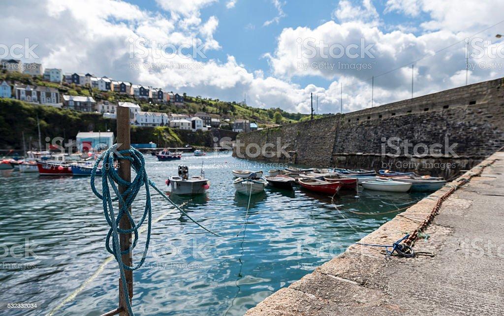 small fishing boats, moored in a Cornish harbor stock photo