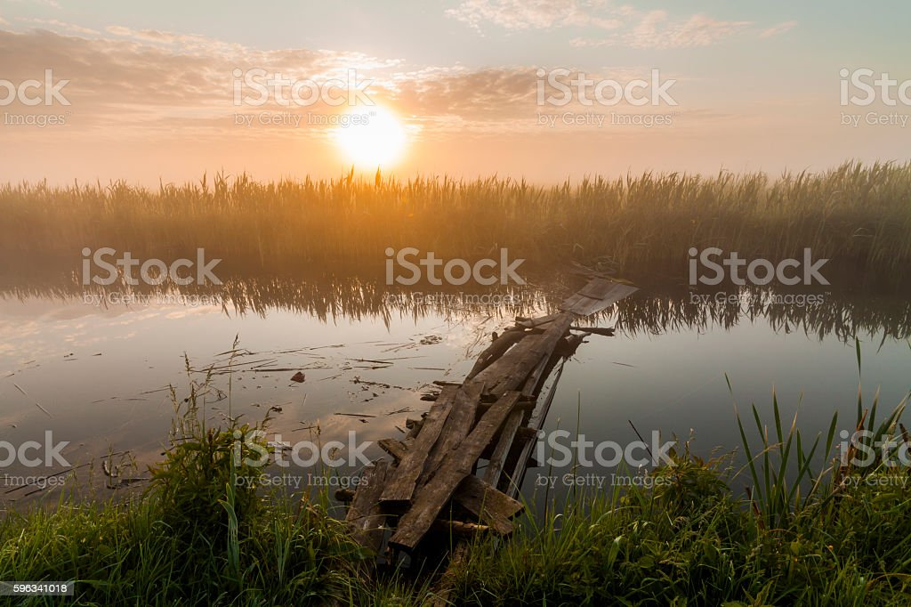 Small fishing bridge on the river in the early morning. royalty-free stock photo