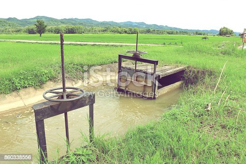 istock small floodgate of irrigation canal for rice field in Thailand. 860338556