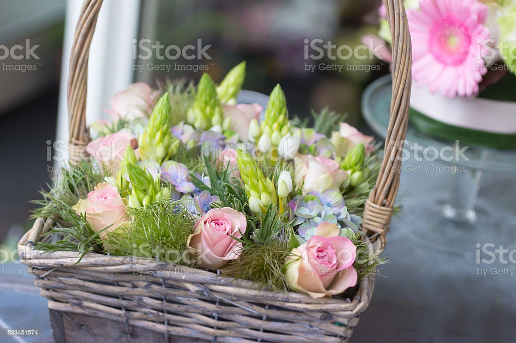 Small Flower basket with roses stock photo